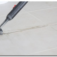 brushing grout tile floor