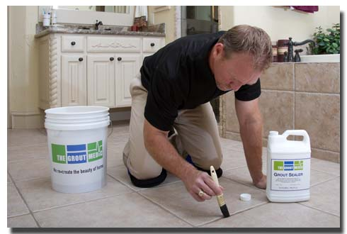 man grout sealing tile floor