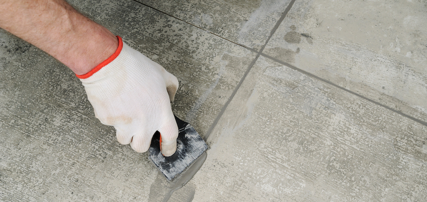 grouting ceramic tiles with rubber trowel